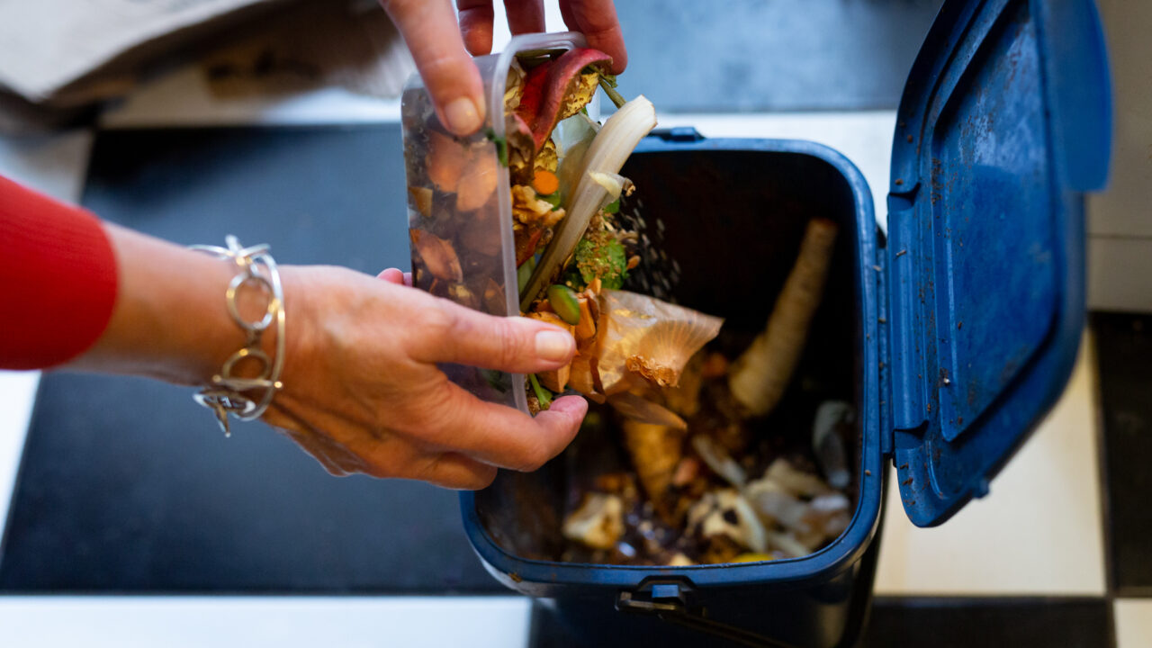 Putting food waste into a food waste bin